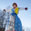 End of the winter. Shrovetide. Big doll for the burning. — Stock Photo