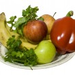 Isolated top view of fruits and vegetables in plate — Stock Photo #17674711