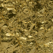 Texture of golden foil — Stock Photo
