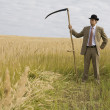Man with scythe — Stock Photo