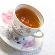 Cup of tea and white lump sugar — Stock Photo