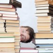 Man between books — Stock Photo #17675447