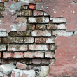 Crannied plaster on red brick wall — Stock Photo