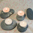 Spa stones with candles - Stock Photo