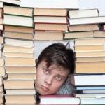 Man between books — Stock Photo #17677471