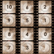 Grunge film countdown in dark color — Stock Photo
