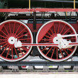 Red locomotive wheels — Stock Photo
