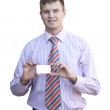 Young man handing a blank business card  — Stock Photo