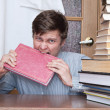 Crazy student gnaws red book - Foto de Stock