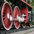 Red locomotive wheels — Stock Photo #17678343