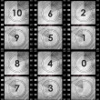 Grunge film countdown in dark color — Stock Photo #17678583