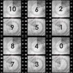 Grunge film countdown in dark color — Stock Photo