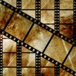 Aged film strip in grunge style - Stock Photo