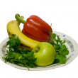 Isolated top view of fruits and vegetables in plate — Stock Photo