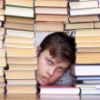 Man between books - Stock Photo