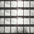 Aged film strip in grunge style — Stock Photo #17679323
