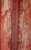 Cracked bright red and white wall — Stock Photo
