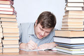 Man between books — Stock Photo