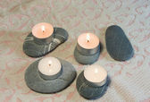 Spa stones with candles — Stock Photo