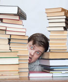 Man between books — Stock Photo