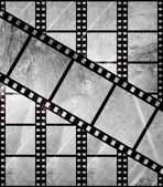 Aged film strip in grunge style — Stock Photo