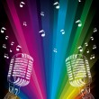 Vector microphone on rainbow — Stock Vector