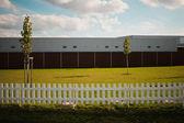 Wooden fence near european supermarket — Stock Photo