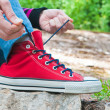 Tie the laces on sneakers 2 - Stock Photo
