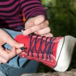 Tie the laces on sneakers — Stock Photo