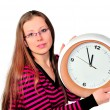 Girl with a watch in his hand — Stock Photo