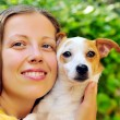 Girl with small dog — Stock Photo #23124628