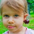 Girl with sweet cherry on ears — Stock Photo #29357445