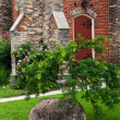 Large boulder near church — Stock Photo #29357601