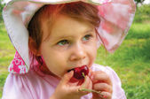 Girl with a sweet cherry — Stock Photo