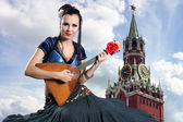 The girl with a balalaika — Stock Photo