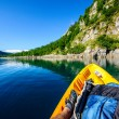 Mountain lake from kayak - Stock Photo