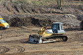 Excavator at work on a construction site — Stock Photo
