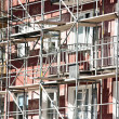 Stock Photo: Renovation of apartment building with scaffolding