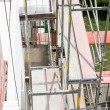 Scaffolding on apartment building — Stock Photo #30156327