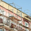 Scaffolding on apartment building — Stock Photo