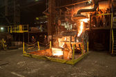 Smelting iron at high temperature in a steel mill. — Stock Photo