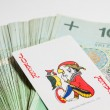 Stock Photo: Joker card on Polish money