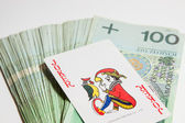 Joker card on Polish money — Stock Photo