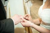 Wedding rings on the fingers — Stock Photo