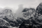 Mountains in the snow and clouds — 图库照片