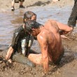 Stock Photo: Young people playing in mud