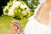 Jewelry the bride and bouquet — Stock Photo