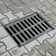 Stock Photo: Sewer manhole in pavement