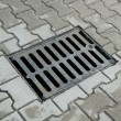 Sewer manhole in pavement — Stock Photo #40532985