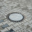 Sewer manhole in pavement — Stockfoto #40533219
